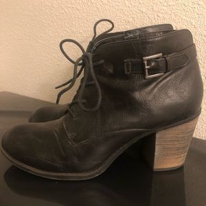 Black lace up and zip booties with 3 in. heel